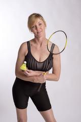 Badminton player wearing sports bra and lyrca shorts
