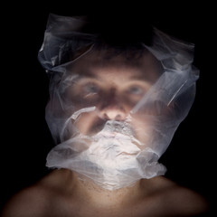 Asphyxia, man with plastic bag in head