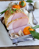 roast pork with mushrooms and tangerines - festive dish