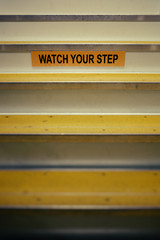 Watch Your Step Sign on Stairway