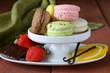 different colorful macaroons (pistachio, chocolate, vanilla)