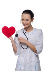 Doctor puts a stethoscope to the heart