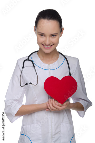 Doctor supporting red heart
