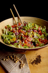 Big bowl of fresh vegetable salad with chickpeas and cumin