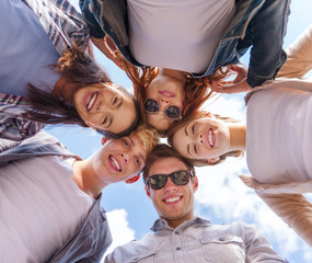 group of teenagers looking down