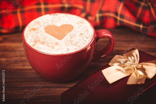 Cup of coffee,  little purple alarm clock and gift box