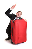 Young man raise up one's hand behind red luggage