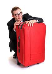 Funny business man hide behind red luggage