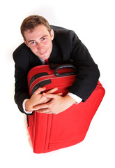 Business man hug luggage