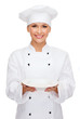 smiling female chef with empty plate