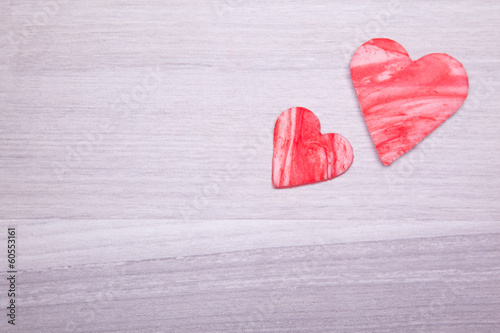 red fondant heart on wooden background