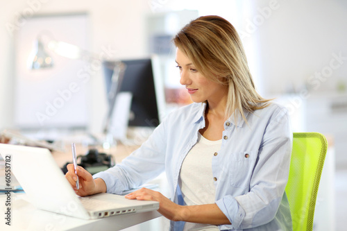 Smiling businesswoman working in office