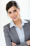 Smiling business girl standing on white background