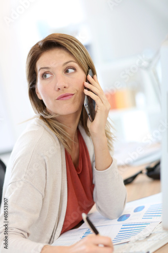 Portrait of confident businesswoman talking on the phone