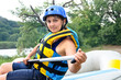 Active woman going river rafting