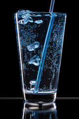 glass with water and Bubbles on a black background