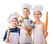 Three young chefs with ladle and rolling pin