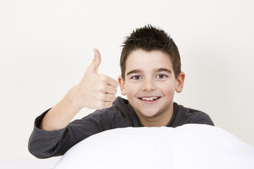 cute little boy with expressions in bed