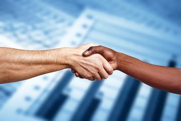 Handshake between multiracial people