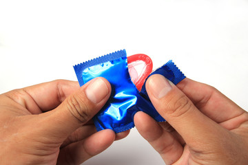 Man's Hands Unwrapping a Condom