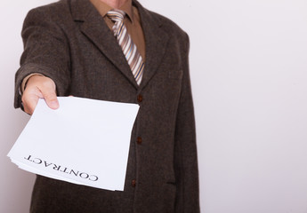 Businessman giving blank paper with sign contract