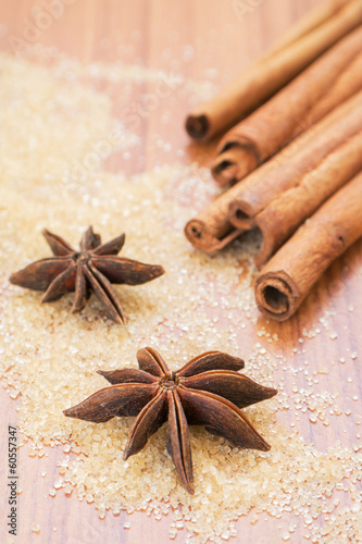 Star anise and cinnamon sticks on brown sugar