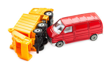 Toy cars in accident on a white background.