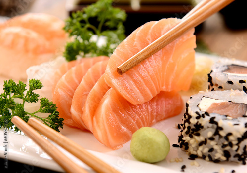 Sashimi and sushi on white plate