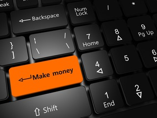 Laptop keyboard with button Make money close-up.