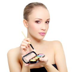 attractive girl with makeup palette isolated on white