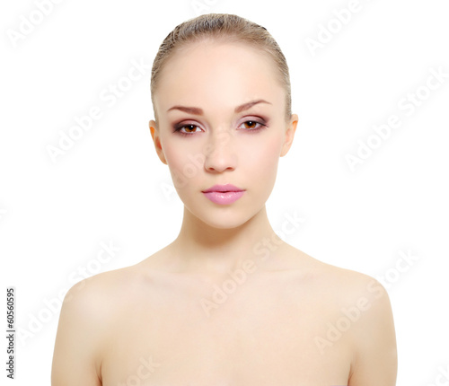 Portrait of girl with clean skin isolated on white