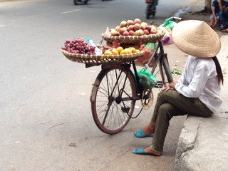 Woman selling fruit on thr streets of Hanoi