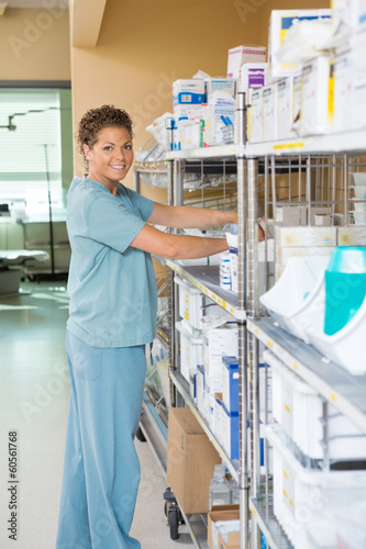 Female Nurse Working In Storage Room