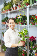woman with Dieffenbachia plant