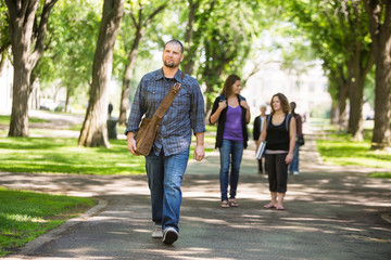 Confident Male Grad Student Walking On Campus