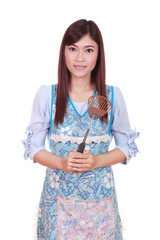 female chef with spade of frying pan