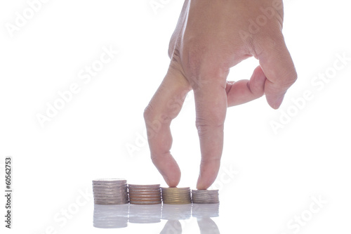 Close-up Of man Hand Put Coins To Stack Of Coins