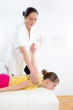 Chiropractor doing adjustment on female patient