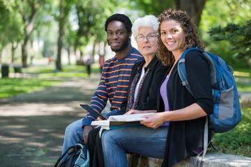 Multiethnic University Students Sitting On Campus