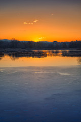 Sunset on iced water