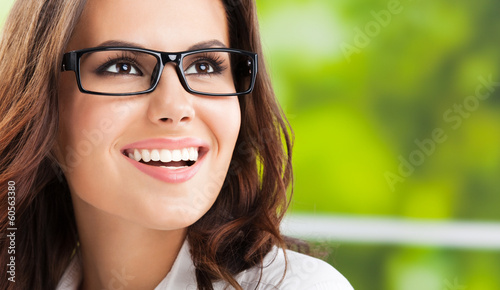 Young smiling cheerful businesswoman at office