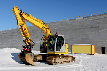 Excavator on a Construction Site in Winter