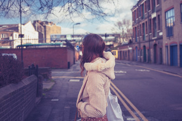 Young woman looking at street and railway line