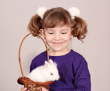 happy little girl hold white bunny