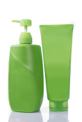Green  bottles of liquid soap on white background