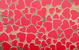 Tiny red hearts on wooden background