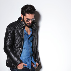side view of a fashion man in leather jacket