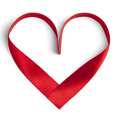Red ribbon in a heart shape isolated on white