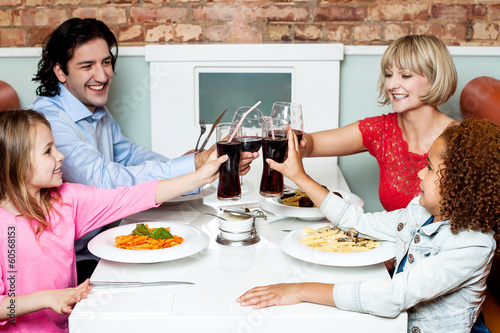 Family raising their glasses before eating