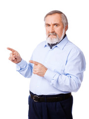 Senior man pointing to empty copy space